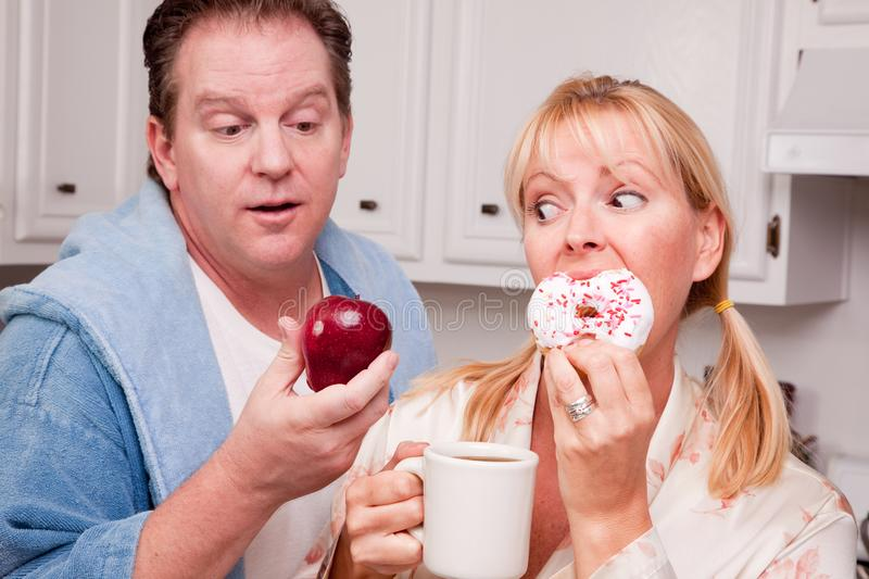 Fruit Or Donut - Healthy Eating Decision Free Stock Photography