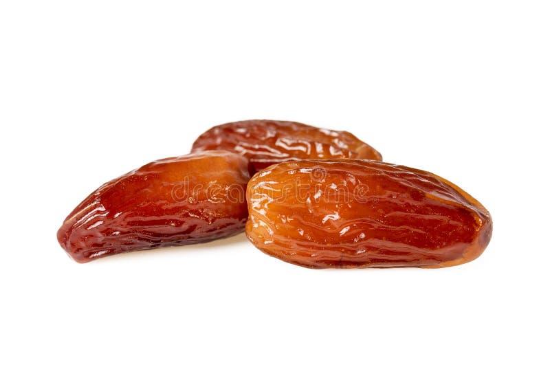 Fruit doux de dates ou trois dattes sèches d'isolement sur le blanc photo stock