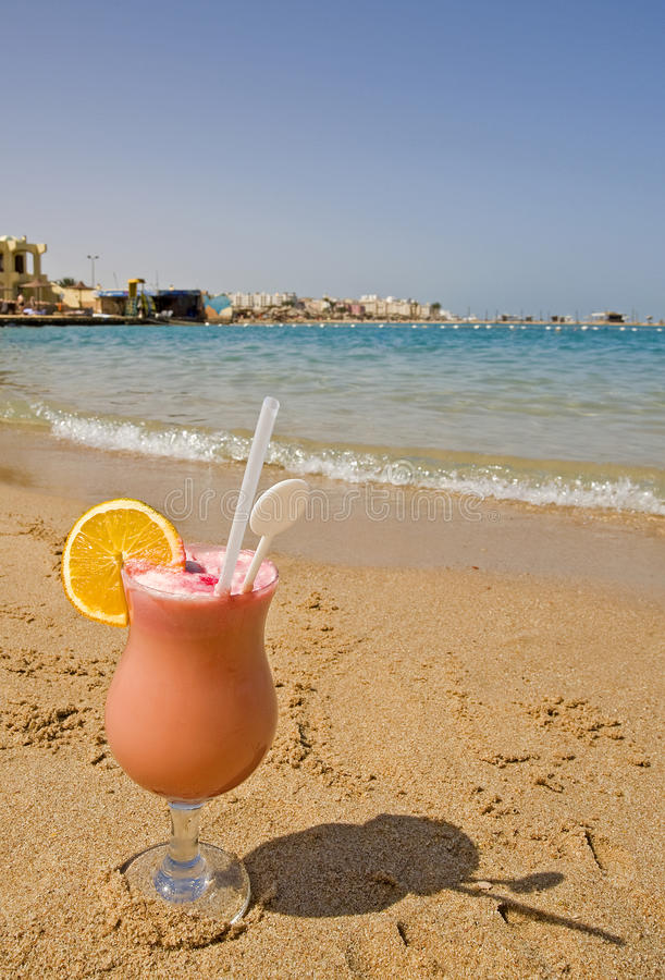 Fruit drink on a beach stock image
