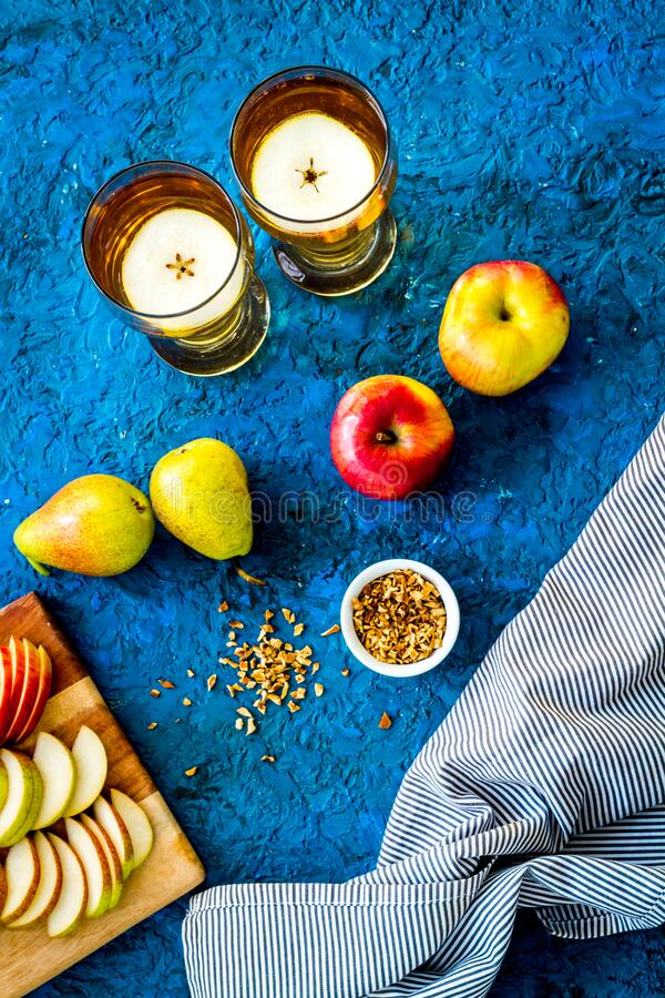 Fruit drinks with apple and pear on blue table top-down stock photography
