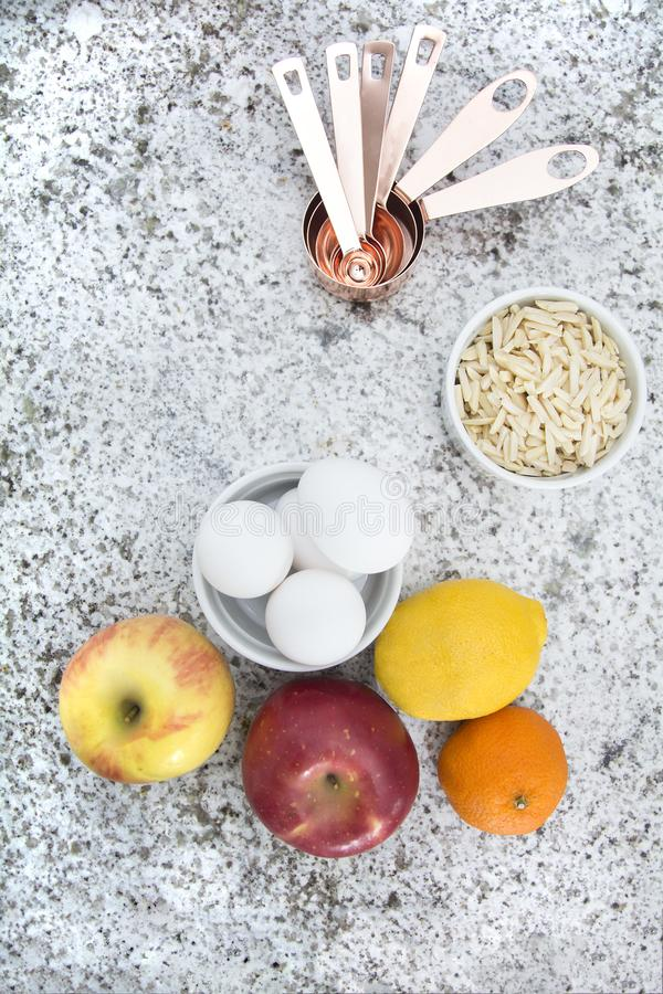 Fruit, eggs and other cooking supplies. Food and other cooking supplies top view on granite countertop for baking royalty free stock images