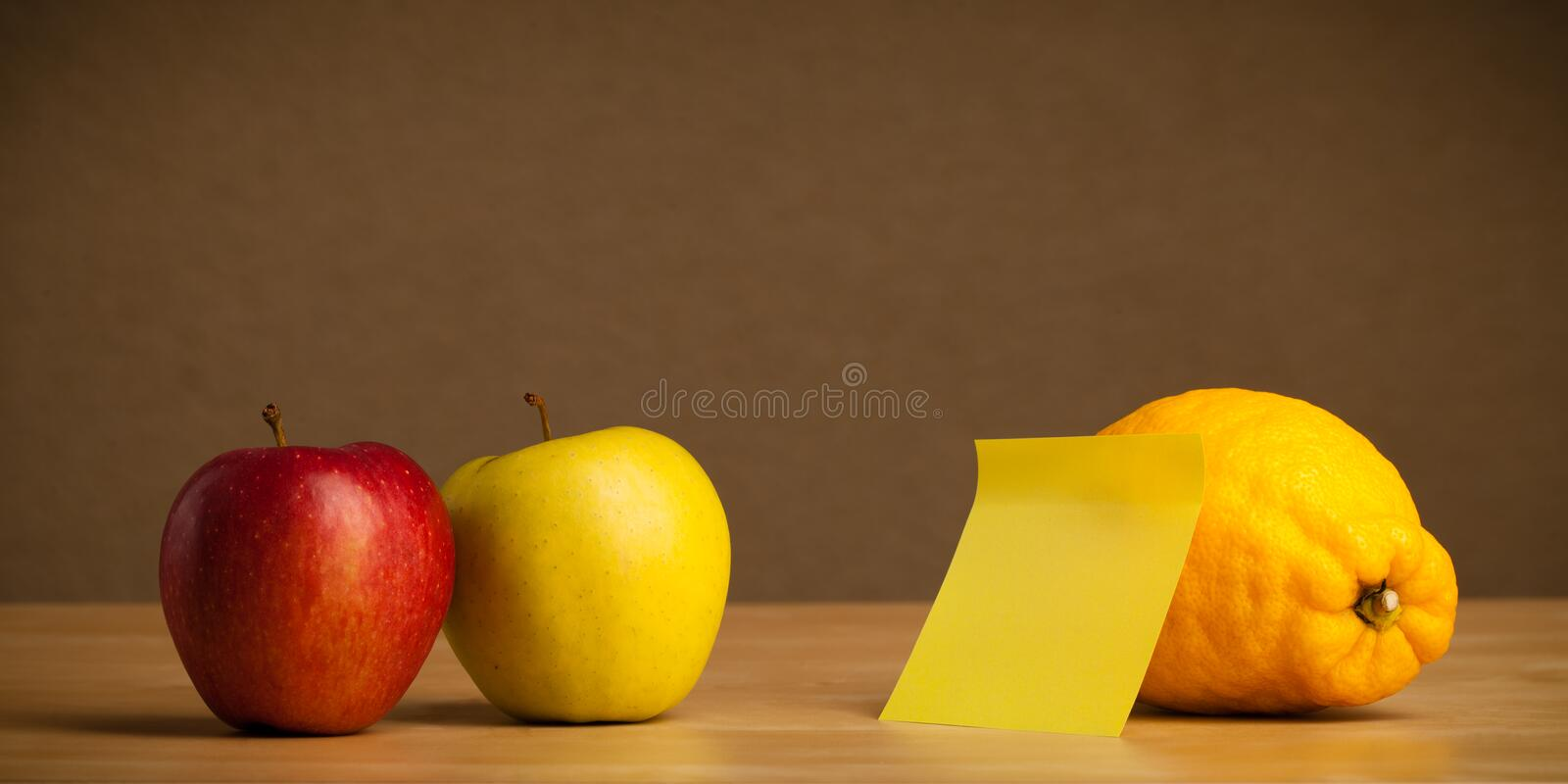 Empty post-it note sticked on fruit. Fruit with empty sticky note royalty free stock images