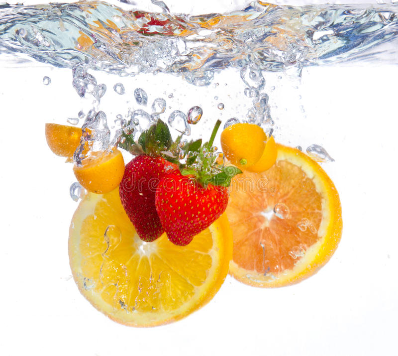 Fruit falling into water royalty free stock photos