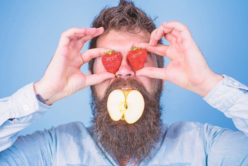 Fruit filling. Hipster surprised enjoy fruit filling. Man stuffed apple. Man handsome hipster long beard eat apple hold royalty free stock photos