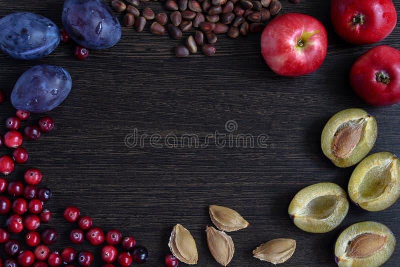 Fruit frame for design and decoration. Fresh fruits on wooden board frame background royalty free stock images