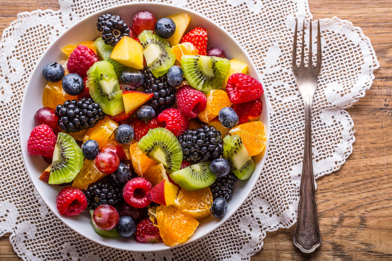 Fruit fresh mixed tropical fruit salad. Bowl of healthy fresh fruit salad - died and fitness concept royalty free stock photography