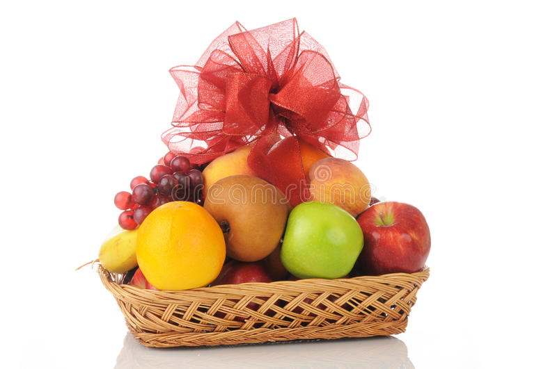 Fruit gift basket. A fruit gift basket with a bow on top stock images