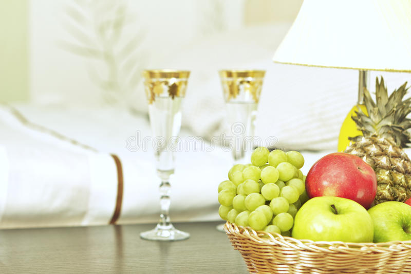 Fruit And Glasses On Table In Interior Stock Image