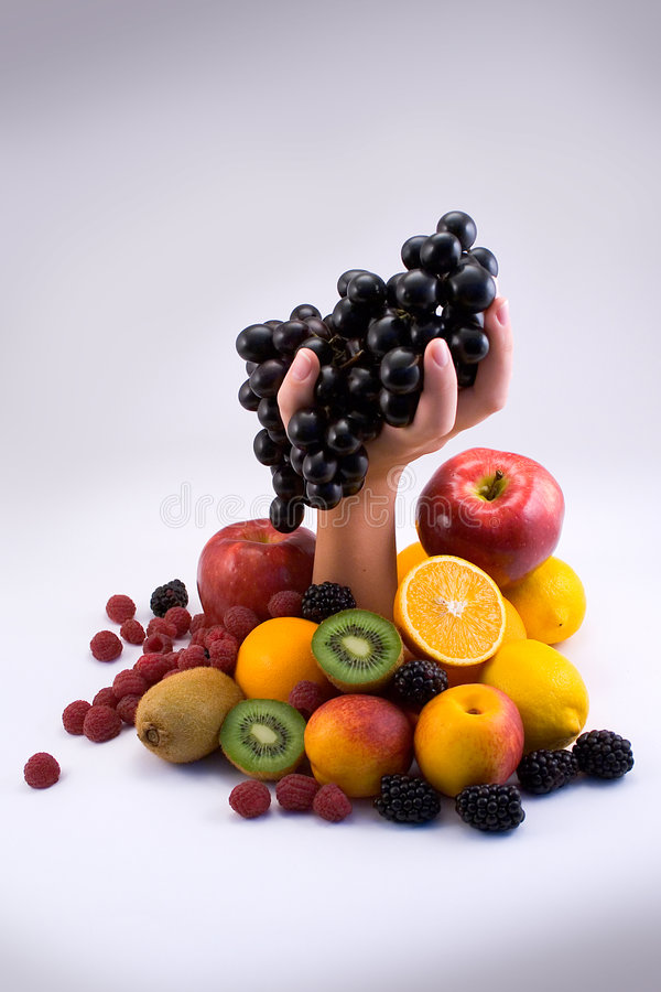 Fruit with hand. Healthy fruits with many vitamins that we need stock photos