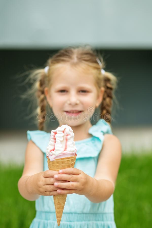 Fruit ice cream in the child`s hands. The concept of childhood, lifestyle, food, summer. Fruit ice cream in the child`s hands. The concept of childhood stock photos