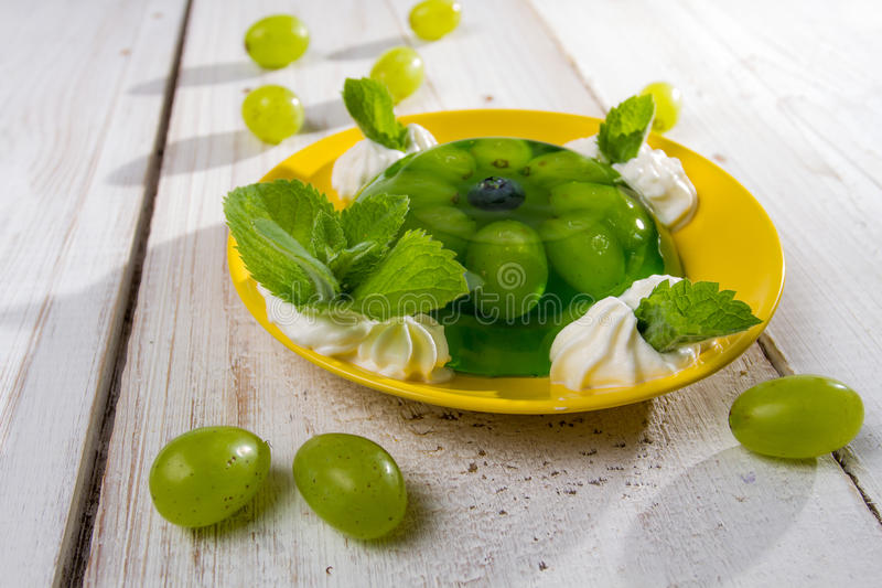 Fruit jelly served with grapes stock image
