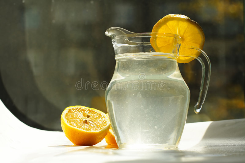 Fruit juice. Countess of fruit juice, lemons on the surface royalty free stock images