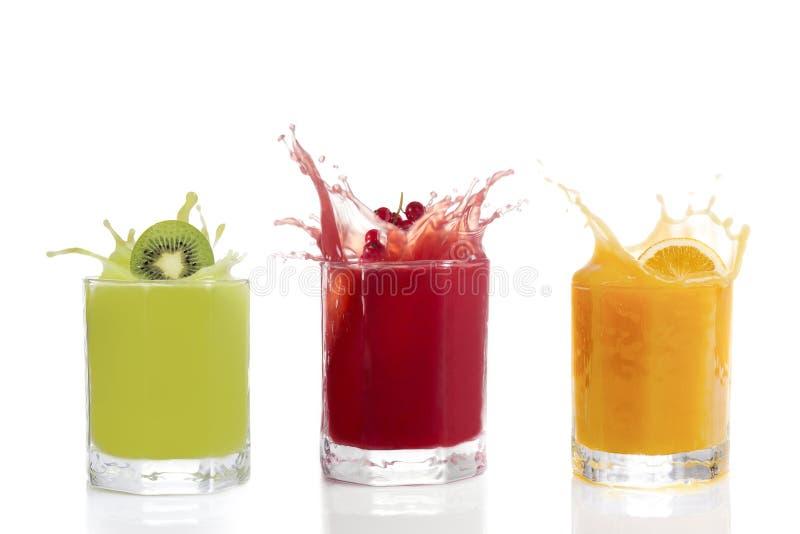 Fruit juice in glasses, Kiwi, currants, orange royalty free stock images