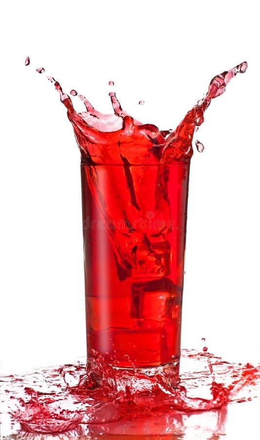 Fruit Juice Splash In A Glas Royalty Free Stock Photos