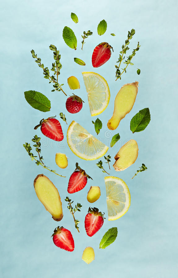 Fruit Lemonade Ingredient Pattern. Summer Food and Drink - Fruit Lemonade Ingredient Pattern made of Strawberry, Ginger, Lemon, Fresh Mint and . Splash Shape stock photo