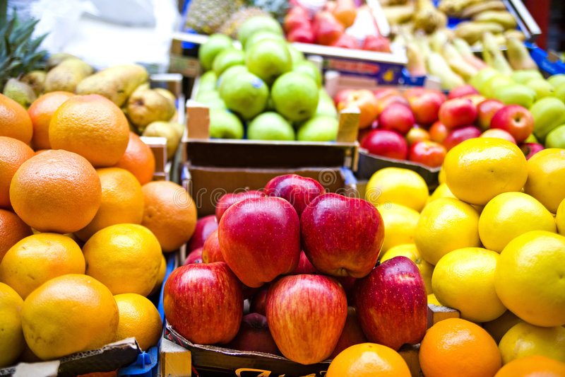 Fruit market. Colorful, tasty fruit in baskets at a market stock photography