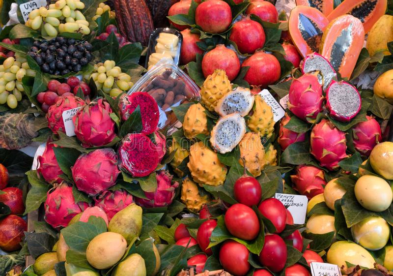 Fruit market, fresh tropical fruits, pitahaya, food background. Fresh ripe juicy fruits and vegetables at a local la Boqueria market in Barcelona, Spain stock photo