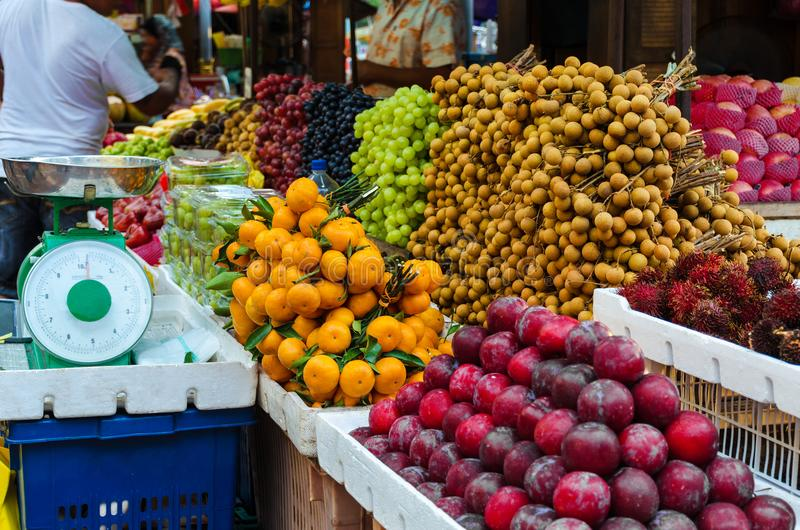 Fruit market at Kuala Lumpur street - many different Asian organic fresh fruits, everyday things. Photo with selective focus shot royalty free stock photos