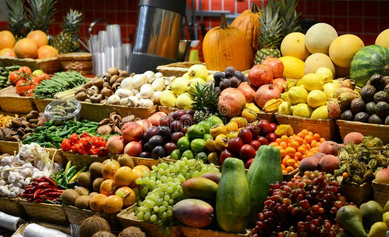 Fruit market with various colorful fresh fruits and vegetables - Market series stock photo