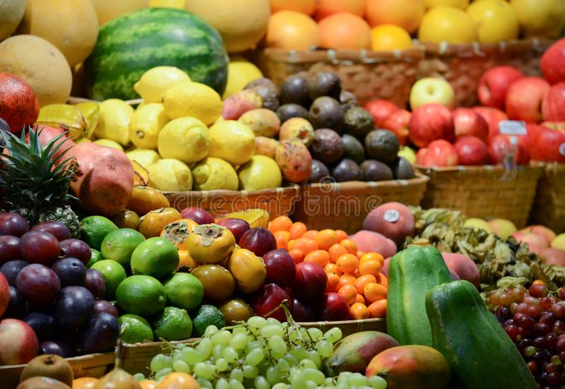 Fruit market with various colorful fresh fruits and vegetables - Market series stock photography