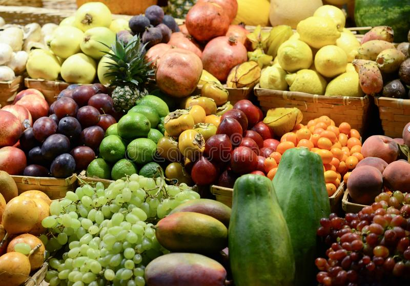 Fruit market with various colorful fresh fruits and vegetables - Market series stock image