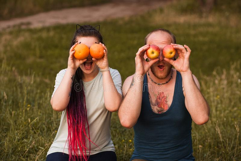 Fruit nature woman man joking healthy concept. royalty free stock photo