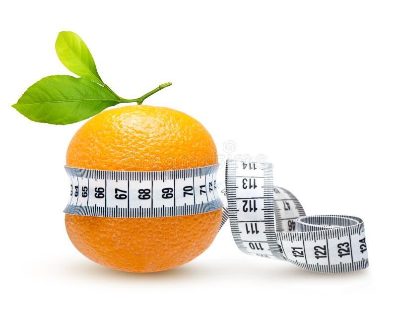 Fruit orange avec la mesure images stock