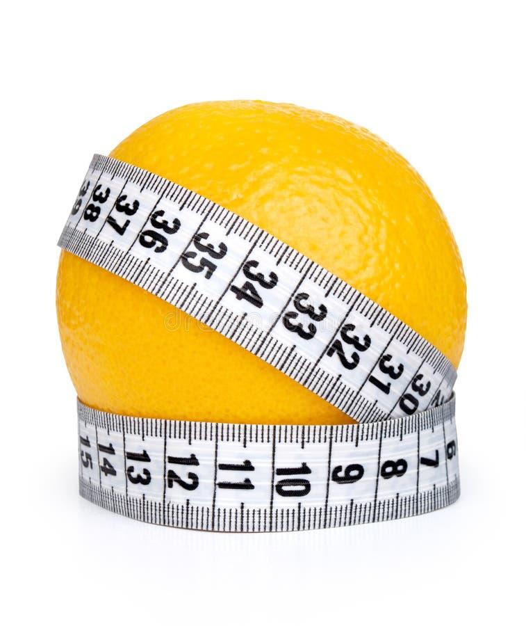 Fruit orange avec le ruban métrique photo libre de droits