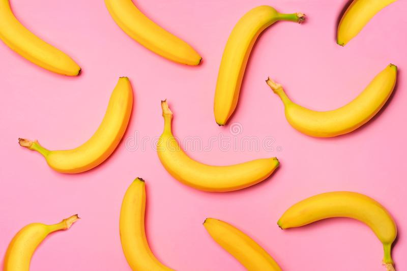 Fruit pattern of bananas over a pink background. Colorful fruit pattern with bananas over a pink background. Top view royalty free stock image