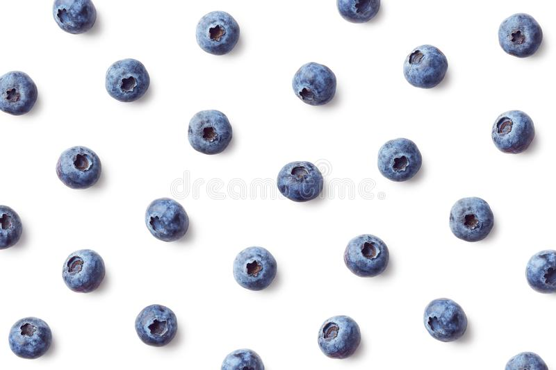 Fruit pattern of blueberries. Isolated on white background. Top view. Flat lay stock photos