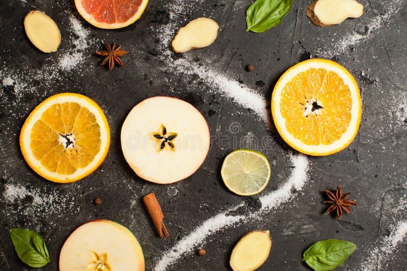 Fruit pattern of fresh orange and apple slices stock photos