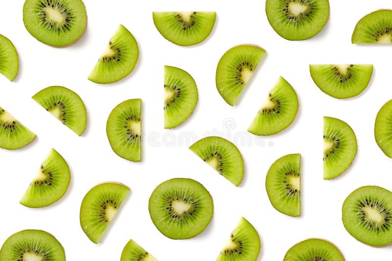 Fruit pattern of kiwi slices. Isolated on white background. Top view. Flat lay royalty free stock photos