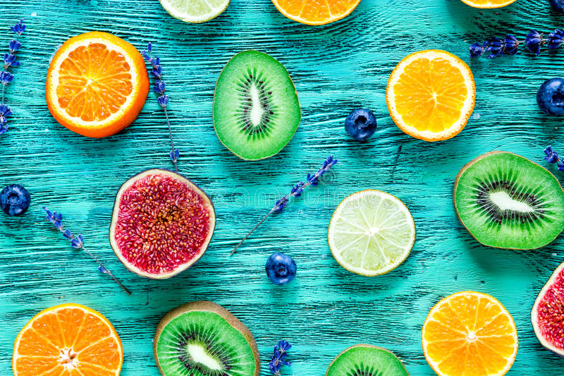 Fruit pattern with lavender and blueberry on blue desk background top view royalty free stock photo