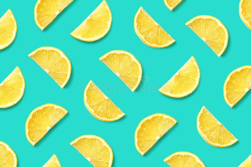 Fruit pattern of lemon slices. Colorful fruit pattern of lemon slices on blue background. Top view. Flat lay stock photo