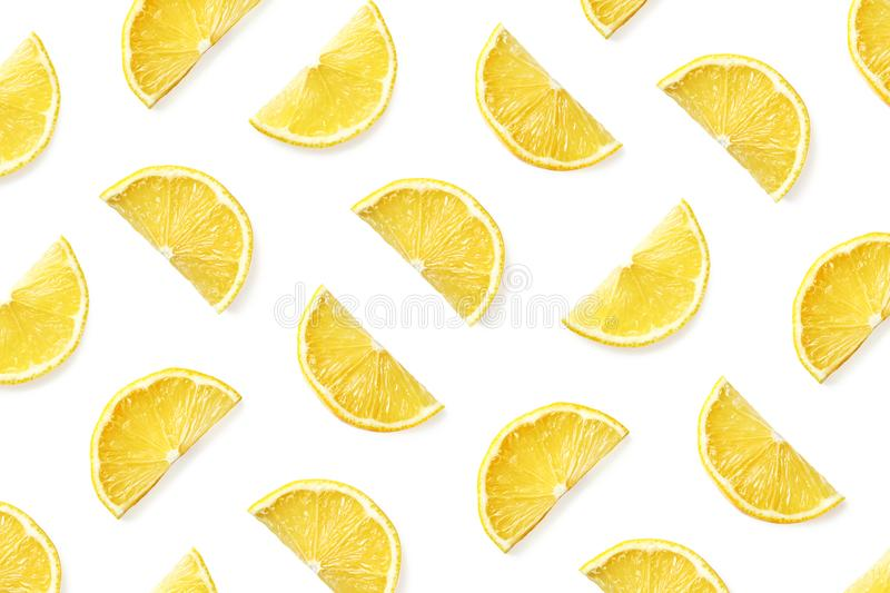 Fruit pattern of lemon slices. Isolated on white background. Top view. Flat lay royalty free stock photo
