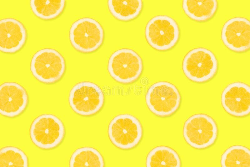 Fruit pattern of lemon slices on a yellow background. Colorful fruit pattern, Lemon slices on a bright yellow background. Top view stock images