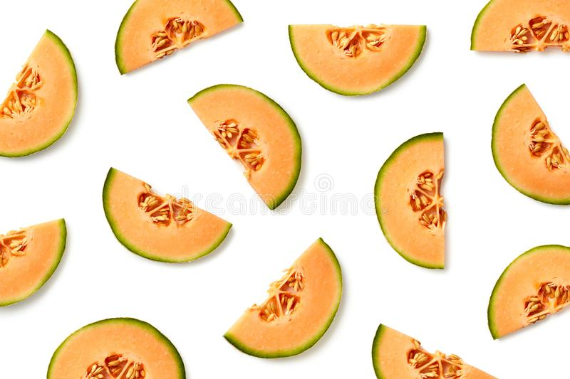 Fruit pattern of melon slices. Isolated on white background. Top view. Flat lay royalty free stock photos