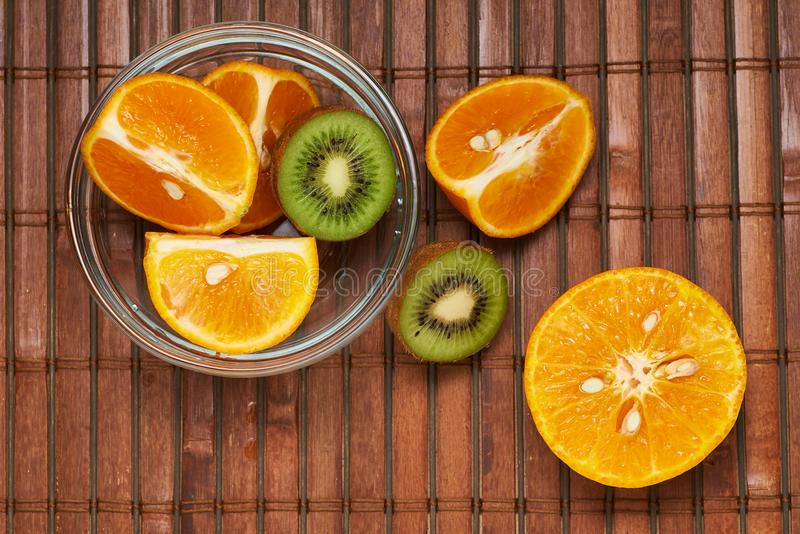 Fruit in a plate on a brown background royalty free stock photos