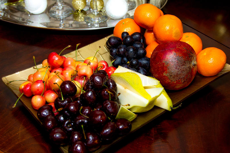 Fruit plate, cherries, Apple, pear royalty free stock photos