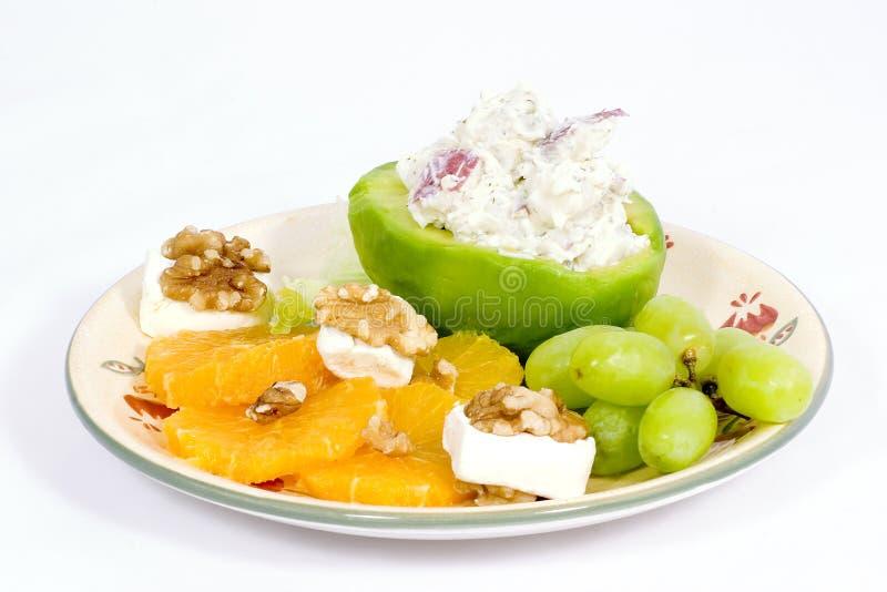 Fruit plate with potato salad royalty free stock photos