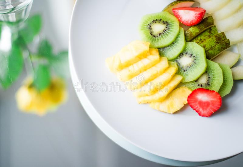 fruit plate served - fresh fruits and healthy eating styled concept stock photos