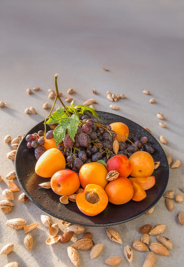 Free Fruit Plate With Grapes, Apricot And Almond. Stock Photography - 94686712