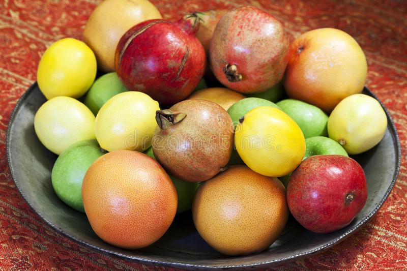 Fruit Platter. Various fresh ripe fruits in the plate stock images
