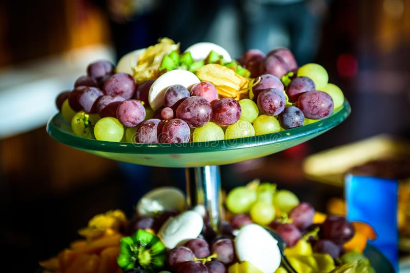 Fruit platter buffet at business or wedding event venue. royalty free stock photos