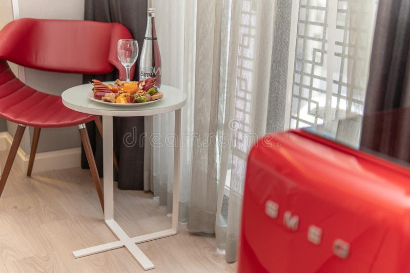 Fruit Platter on table with red chair. Fruit platter in hotel room with red chair in background, bar, dinner, food, home, party, restaurant, vacation, beach stock photos