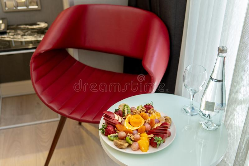 Fruit Platter on table with red chair royalty free stock photo