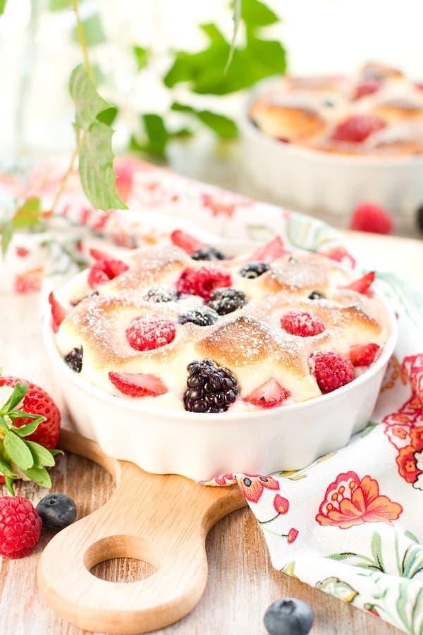Fruit pudding(clafoutis) with berry. Strawberry; raspberry; blueberry; blackberry royalty free stock photos