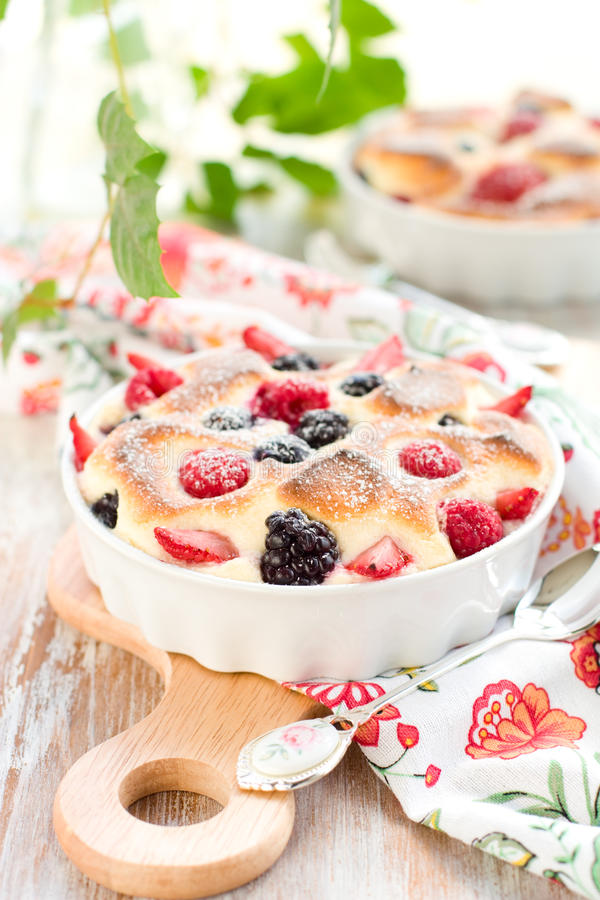 Fruit pudding(clafoutis) with berry. Strawberry; raspberry; blueberry; blackberry royalty free stock images