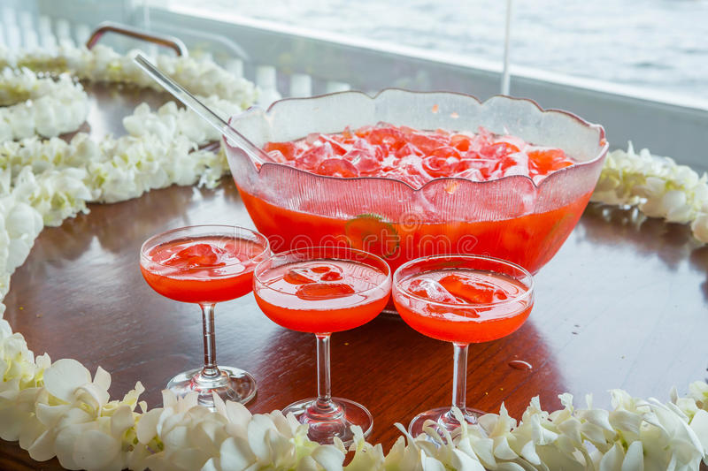 Fruit punch. With ice served in beautiful big glass bowl royalty free stock photos