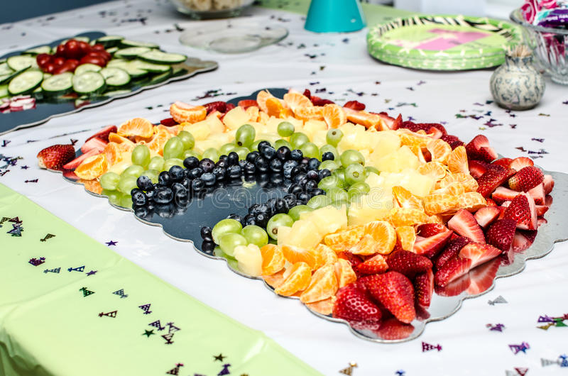 Fruit Rainbow. A fruit rainbow with strawberries, oranges, pineapples, grapes and blueberries stock photo